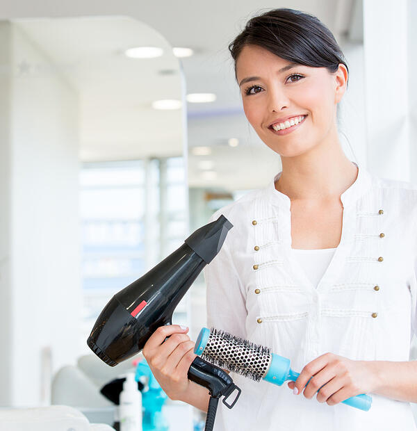 Female stylist at the beauty salon looking very happy