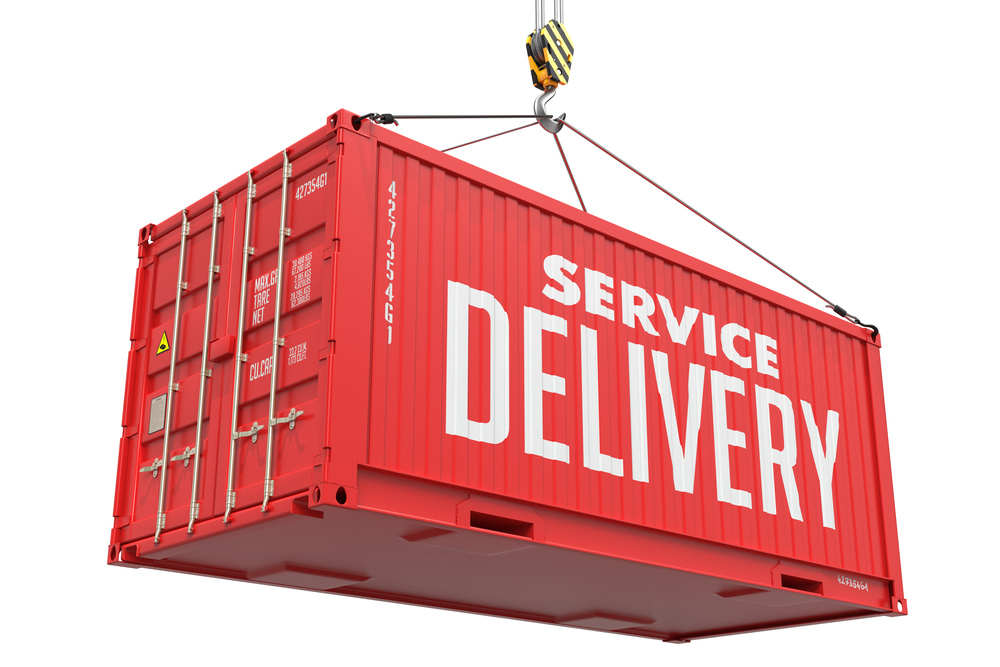 Service Delivery - Red Cargo Container hoisted by hook, Isolated on White Background.
