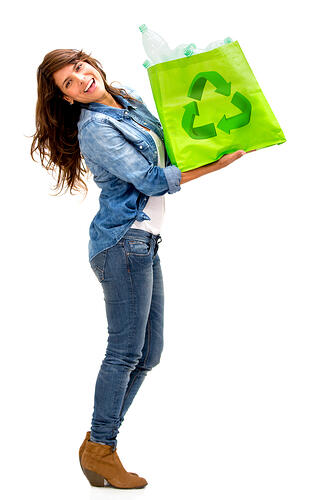 Woman with a recycle bag - isolated over a white background