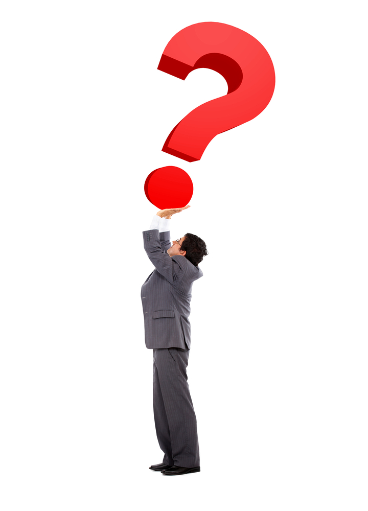 Wondering business man with a question mark isolated over white